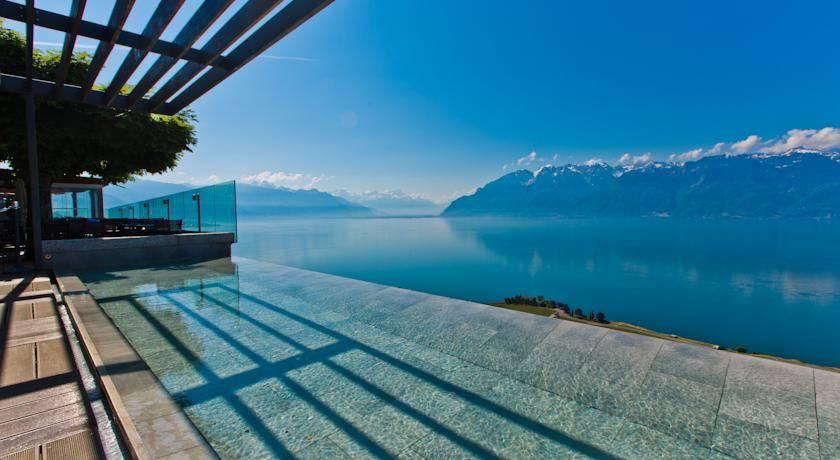 Photo 1: Mangez avec l'une des plus belles vue au monde